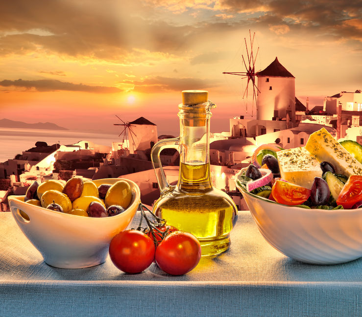39900648 - greek salad against windmill in oia village santorini island in greece
