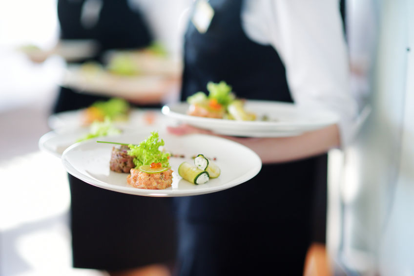 48973390 - waiter carrying plates with meat dish on some festive event, party or wedding reception